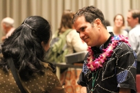 The Forum's facilitator, Johnathan Scheuer, greets a participant.