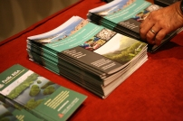 Copies of the report, executive summary, and case studies (shown) were available to members of the public at the forum.